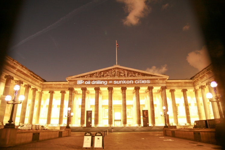 """Ahead of BP AGM, campaigners project """"Drop BP"""" onto the British Museum's iconic facade. Photo by Diana More."""