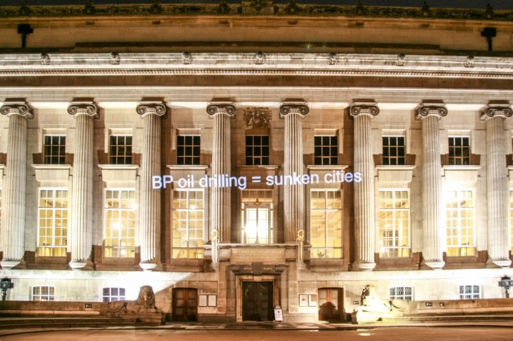 """Campaigners projected onto British Museum's iconic building as members attended a lecture on new BP-sponsored exhibition, aptly title """"Sunken Cities"""". Photo by Diana More."""