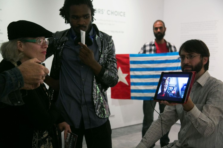 Visitors at the NPG watch a film by West Papuan activist Raki Ap about BP's activities. Photo by Kristian Buus