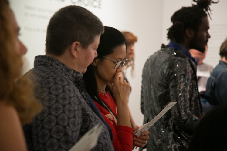 Visitors read leaflets about rebel exhibit at the NPG. Photo by Kristian Buus