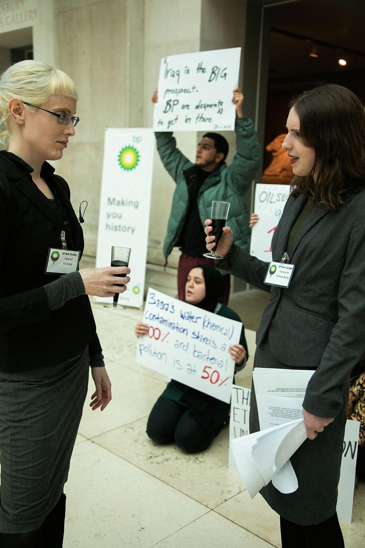 Fake BP staff and Iraqi protesters greet press at BP-sponsored